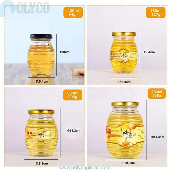 Un frasco de vidrio de hermosa miel, un frasco de vidrio de primera calidad