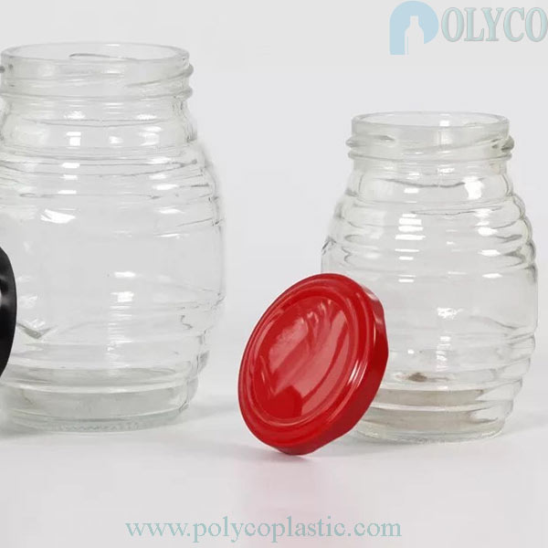 Un hermoso frasco de vidrio que contiene miel