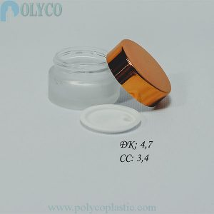 Glass jar containing beautiful cosmetics, many different sizes