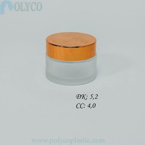 Round glass jar containing beautiful cosmetics, many different sizes