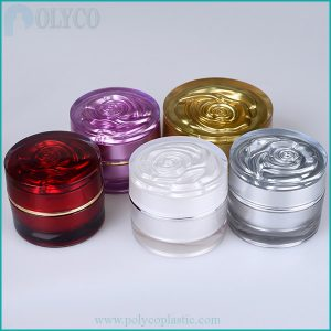 Cosmetic bottle with rose cap