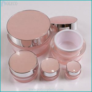Pink cosmetic jars of different sizes