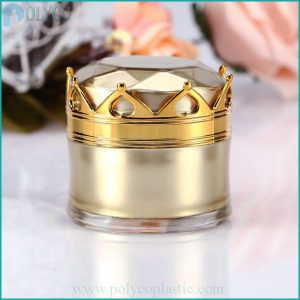 Plastic cosmetic jar with a golden crown
