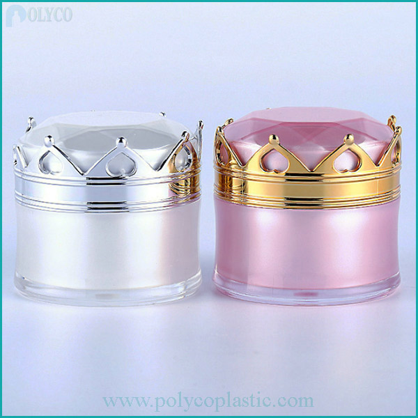 Plastic jars containing crown-shaped cosmetics