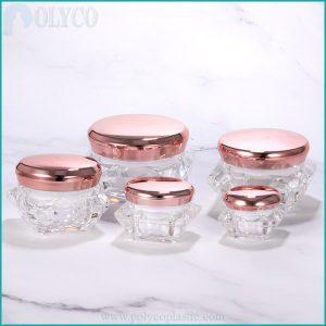 Plastic jar containing pink lid