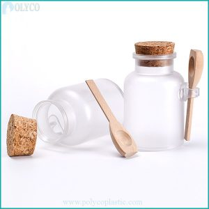 The transparent plastic jar has a lovely wooden lid