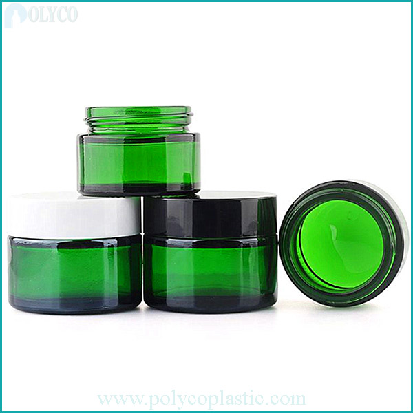 Green cosmetic glass jars
