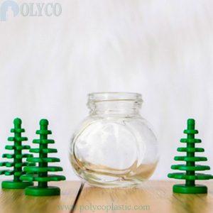 Transparent colored tilted glass bottle