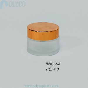 Round glass jar with golden lid